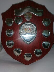 """Michael Curran Perpetual Shield. We had great celebrations with our fine athletes on Monday morning. The school retained """"The Shield"""" at the St Joseph's AC schools meet in Albatross on Friday night. See the video link below to the celebrations among our pupils when the result was announced on Friday night. Mr Cassin also introduced our 27 junior infants to the other pupils<br>this morning. We wish them a happy stay in Scoil Mholinge and look forward to working with them in the coming months and years."""